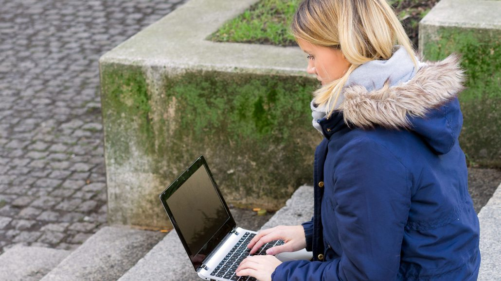 Girl Visiting Online Campus via Computer