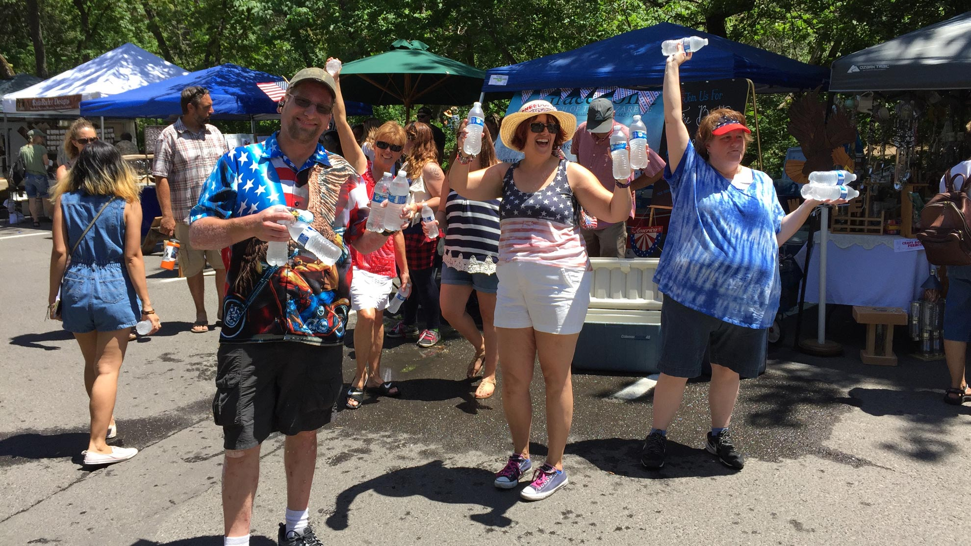 Tim, Donna, John, Tiffany, Cynthia, and Angelia Handing Out Water